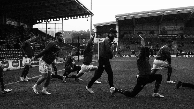Bending in shape...the Chesterfield players warm up