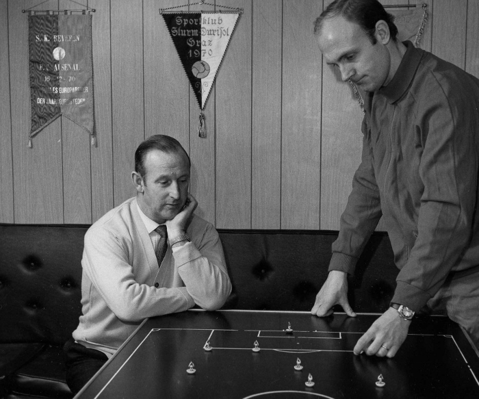 Bertie Mee and Don Howe relax over a game of Subbuteo as they try to work out a plan to erode Leeds United's big lead at the top