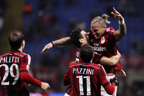 AC Milan's Philippe Mexes (R) celebrates with his teammates (L-R) Gabriel Paletta, Giampaolo Pazzini and Daniele Bonera after scoring against Hellas Verona during their Italian Serie A soccer match at San Siro Stadium in Milan March 7, 2015. REUTERS/Giorgio Perottino (ITALY - Tags: SPORT SOCCER)