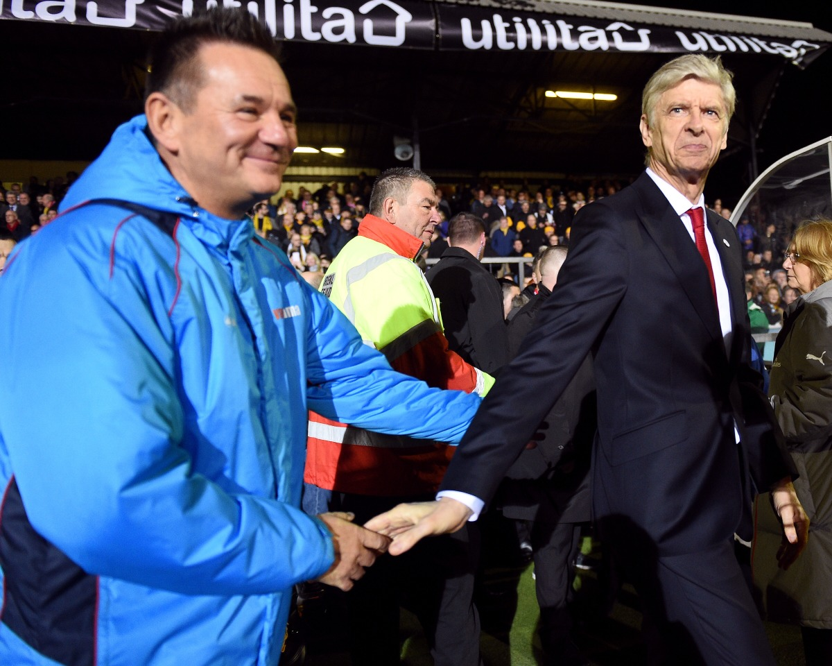 Sutton United's manager Paul Doswell (left) and Arsenal manager Arsene Wenger shake hands before the game Photo: PA